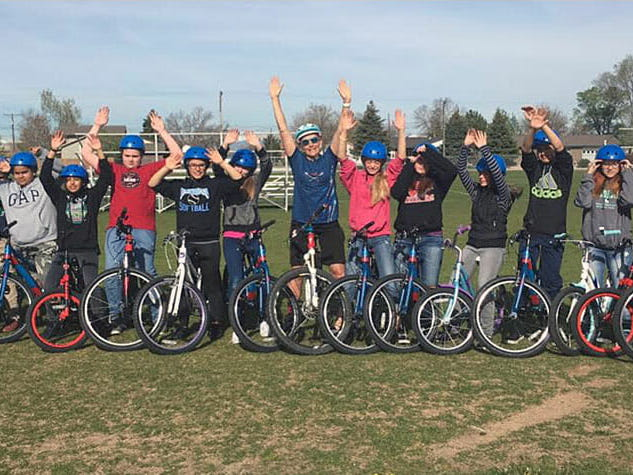Following teacher's favorite activity, students pedal their way to improved fitness