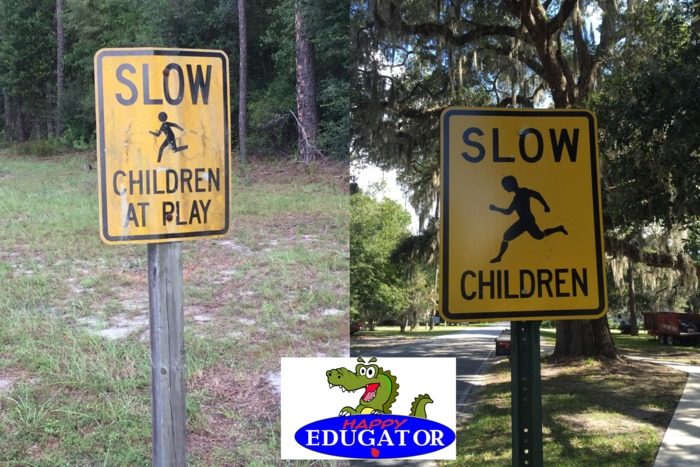 Dollar Stock Photos - Slow Children at Play Signs